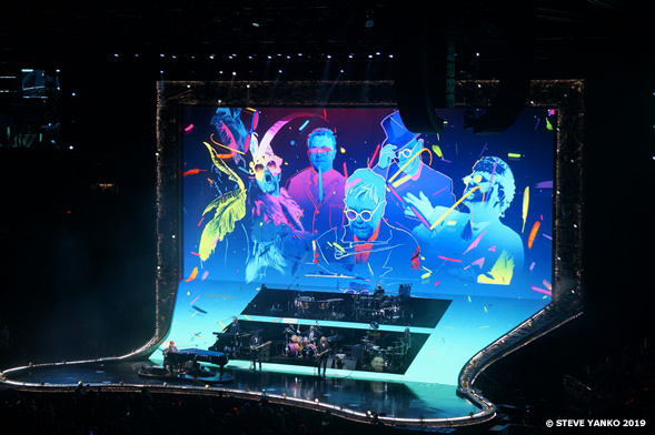 Concert stage. The many faces of Elton John.