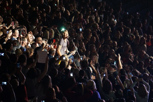 Keith Urban performing amongst his fans. Photo by Steve Yanko.